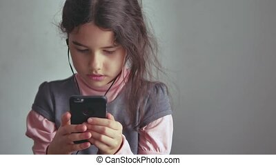 Teen girl smartphone listening to music on your the phone...