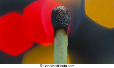 Wooden match burning