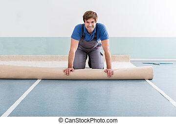 Young Man Laying Carpet