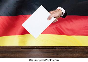 Person Putting Vote In A Ballot Box