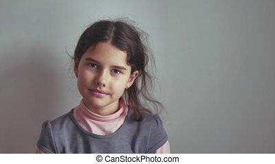 teen school girl smiling on gray background indoor the...