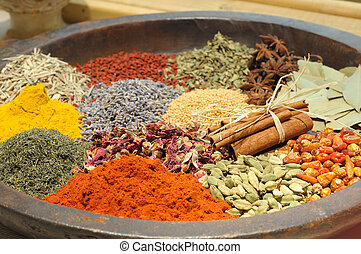 spice - stone bowl of colorful spice and herbs