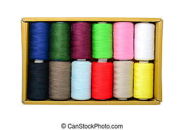 Spools of thread in box isolated on white