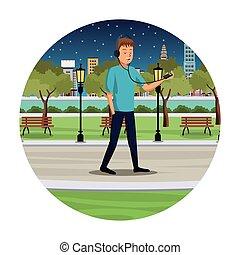 young man listen music walk park view night