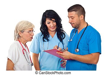 Doctors with clipboard having converation - Three diverse...