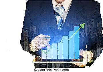 Double exposure of businessman using tablet with growth financial graph chart and building background.