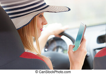 Woman using phone while driving her car - Distracted driver....