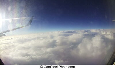 Clouds Seen Through the Window of Jet Airplane - View from...
