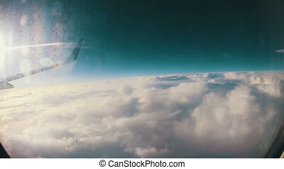 Traveling by Air. View through Airplane Window - View from...