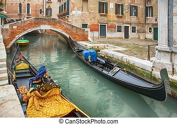 Gondolas and canals in Venice, Italy - Gondolas at the...