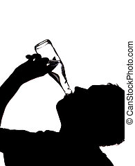 silhouette of a man drinking