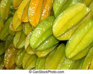 Star fruit or Carambola for sale at the market. Fresh and...
