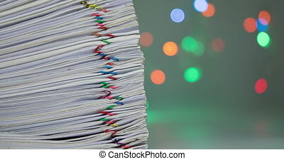 Pile of paperwork have colorful bokeh as background time lapse