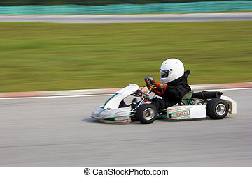 Karting Action Blurred - Image of a go-kart racer competing...