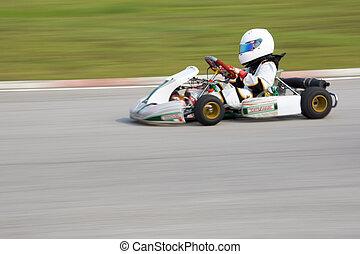 Karting Action (Blurred) - Image of a go-kart racer...