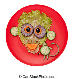 Funny monkey made of cucumber and salad on plate