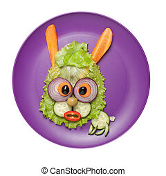 Surprised hare made of salad and cucumber on plate