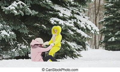 Family of two enjoy winter snowy day and playing snowballs...