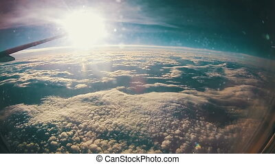 Traveling by Air. View through Airplane Window on Sun...