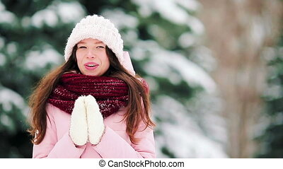 Portrait of young woman at snow weather outdoors on...