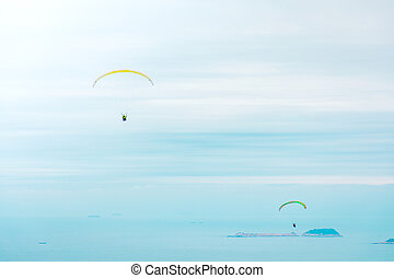 Paragliding above the ocean in Hong Kong East