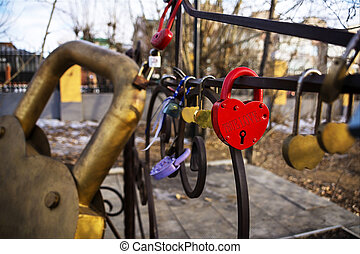 """On the red lock in the shape of a heart inscription """"True love"""""""