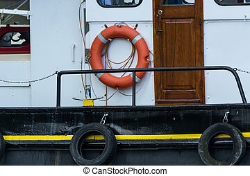 Old steel boat with lifebuoy