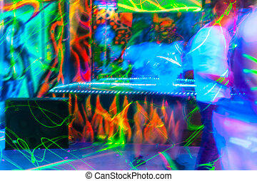 People having fun in a disco. blur effect for an artistic...