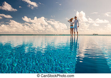 Couple at the poolside