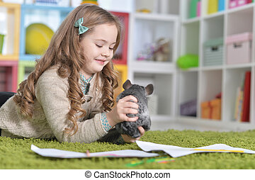 Girl playing with chinchilla - Portrait of a ?ute little...