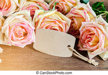 Pink rose with empty paper tag. - Pink rose with empty paper...