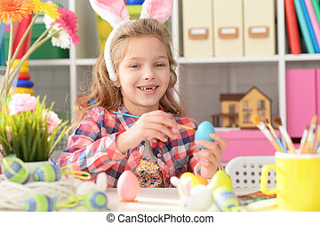 Happy girl with bunny ears getting ready for Easter