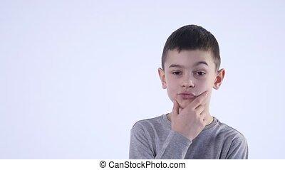 Boy thinking over white background.
