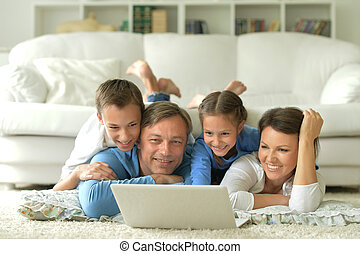 big happy family watching something on laptop