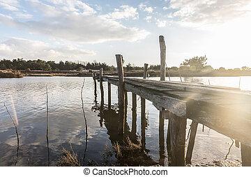Wooden pontoon on Auzance river in Brem-sur-mer, France
