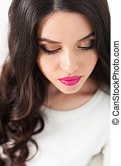 Magnificent portrait of a beautiful young woman with perfect skin closeup