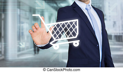 Businessman touching technology interface with trolley -...