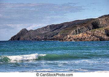 Waves breaking on rocky Welsh coastline
