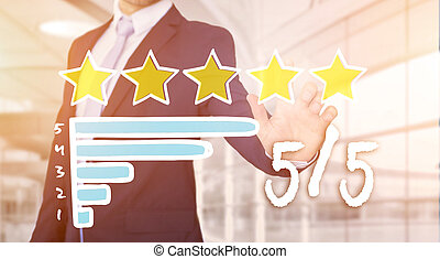 Businessman touching technology interface with ranking stars...