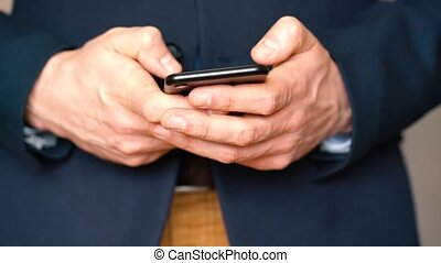 Businessman using smartphone for text messaging