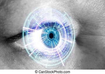 Eye of a woman with digital interface in front of it - View...
