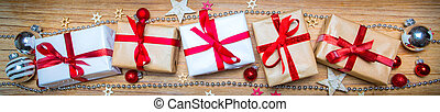 Banner of Christmas wooden background withgift and...