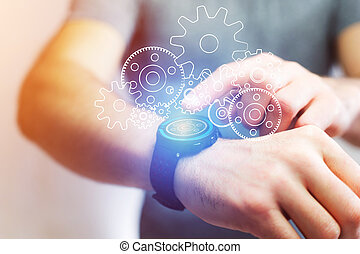 Concept of cogwheel setting going out of a smartwatch -...