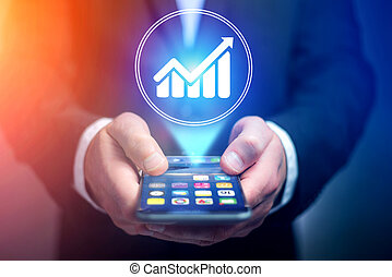 Businessman hand holding mobile phone with chart icon