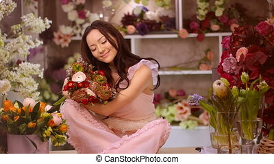 Woman and flowers. Asian girl with bouquets