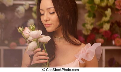 Woman and flowers. Asian girl portrait with bouquet