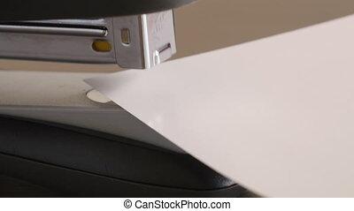Close-up staples pliers paper - Close-up caucasian male...