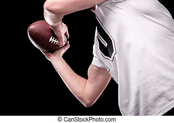 Low angle partial view of man in white t-shirt holding rugby...