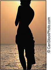 Silhouette of a girl on the coast