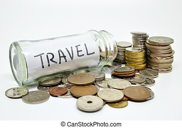 Travel lable in a glass jar with coins spilling out isolated...